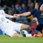 GLASGOW, SCOTLAND - NOVEMBER 15:  Alan Hutton of Scotland tackles Brek Shea of the USA during the international friendly at Hampden Park on November 15, 2013 in Glasgow, Scotland.  (Photo by Jeff J Mitchell/Getty Images)