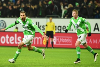 WOLFSBURG, GERMANY - JANUARY 30:  Bas Dost of Wolfsburg celebrate scoring his second goal during the Bundesliga match between VfL Wolfsburg and FC Bayern Muenchen at Volkswagen Arena on January 30, 2015 in Wolfsburg, Germany.  (Photo by Stuart Franklin/Getty Images for MAN)