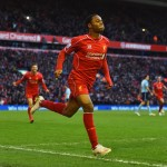 LIVERPOOL, ENGLAND - JANUARY 31: Raheem Sterling of Liverpool celebrates scoring the opening goal during the Barclays Premier League match between Liverpool and West Ham United at Anfield on January 31, 2015 in Liverpool, England.  (Photo by Shaun Botterill/Getty Images)