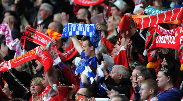 LIVERPOOL, ENGLAND - APRIL 15:  (THE SUN OUT, THE SUN ON SUNDAY OUT) (NO SALES)  In this handout image provided by Liverpool FC, members of the congregation hold aloft Everton and Liverpool scarves during the 24th Hillsborough Anniversary Memorial Service at Anfield on April 15, 2013 in Liverpool, England. Thousands of fans, friends and relatives took part in the service at Liverpool's Anfield Stadium to mark the 24th anniversary of the Hillsborough disaster. A total of 96 Liverpool supporters lost their lives during a crush at an FA Cup semi final against Nottingham Forest at the Hillsborough football ground in Sheffield, South Yorkshire in 1989. (Photo by Liverpool FC via Getty Images)