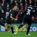 SOUTHAMPTON, ENGLAND - FEBRUARY 22:  Philippe Coutinho (L) of Liverpool celebrates after scoring the opening goal during the Barclays Premier League match between Southampton and Liverpool at St Mary's Stadium on February 22, 2015 in Southampton, England.  (Photo by Jamie McDonald/Getty Images)