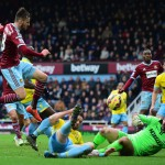 LONDON, ENGLAND - FEBRUARY 28:  Carl Jenkinson of West Ham United is foiled by goalkeeper Julian Speroni of Crystal Palace during the Barclays Premier League match between West Ham United and Crystal Palace at Boleyn Ground on February 28, 2015 in London, England.  (Photo by Jamie McDonald/Getty Images)
