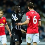 NEWCASTLE UPON TYNE, ENGLAND - MARCH 04:  Manchester United player Jonny Evans (r) looks on as Papiss Cisse of Newcastle has words during the Barclays Premier League match between Newcastle United and Manchester United at St James' Park on March 4, 2015 in Newcastle upon Tyne, England.  (Photo by Stu Forster/Getty Images)