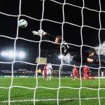 SWANSEA, WALES - MARCH 16: Simon Mignolet of Liverpool makes a save from Gylfi Sigurdsson of Swansea City during the Barclays Premier League match between Swansea City and Liverpool at Liberty Stadium on March 16, 2015 in Swansea, Wales.  (Photo by Mike Hewitt/Getty Images)