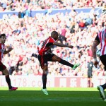 SUNDERLAND, ENGLAND - APRIL 05: Jermain Defoe of Sunderland scores the opening goal during the Barclays Premier League match between Sunderland and Newcastle United at Stadium of Light on April 5, 2015 in Sunderland, England.  (Photo by Matthew Lewis/Getty Images)
