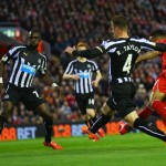 LIVERPOOL, ENGLAND - APRIL 13:  Raheem Sterling of Liverpool beats the Newcastle United defence to score their first goal during the Barclays Premier League match between Liverpool and Newcastle United at Anfield on April 13, 2015 in Liverpool, England.  (Photo by Clive Brunskill/Getty Images)