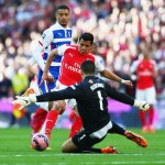 LONDON, ENGLAND - APRIL 18:  Alexis Sanchez of Arsenal shoots past Adam Federici of Reading during the FA Cup Semi Final between Arsenal and Reading at Wembley Stadium on April 18, 2015 in London, England.  (Photo by Matthew Lewis/Getty Images)