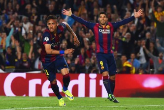 BARCELONA, SPAIN - APRIL 21:  Neymar of Barcelona celebrates with Luis Suarez (R) as he scores their second goal during the UEFA Champions League Quarter Final second leg match between FC Barcelona and Paris Saint-Germain at Camp Nou on April 21, 2015 in Barcelona, Spain.  (Photo by David Ramos/Getty Images)