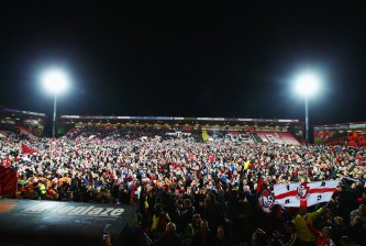 BOURNEMOUTH, ENGLAND - APRIL 27:  Fans invade the pitch after victory in the Sky Bet Championship match between AFC Bournemouth and Bolton Wanderers at Goldsands Stadium on April 27, 2015 in Bournemouth, England. Bournemouth's 3-0 victory puts them on the brink of promotion to the Barclays Premier League.  (Photo by Clive Rose/Getty Images)