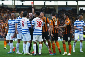 HULL, ENGLAND - FEBRUARY 21:  Joey Barton of QPR (8) is shown a red card and is sent off by referee Anthony Taylor during the Barclays Premier League match between Hull City and Queens Park Rangers at KC Stadium on February 21, 2015 in Hull, England.  (Photo by Matthew Lewis/Getty Images)