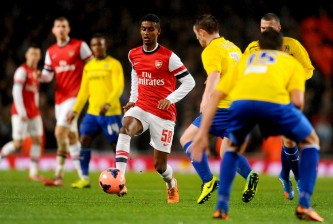 LONDON, ENGLAND - JANUARY 24:  Gedion Zelalem of Arsenal is faced by John Fleck of Coventry City during the FA Cup with Budweiser Fourth round match between Arsenal and Coventry City at Emirates Stadium on January 24, 2014 in London, England.  (Photo by Mike Hewitt/Getty Images)