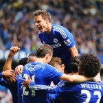 LONDON, ENGLAND - MAY 03:  Cesar Azpilicueta of Chelsea (top) and team mates mob Eden Hazard (obscured) as he scores their first goal during the Barclays Premier League match between Chelsea and Crystal Palace at Stamford Bridge on May 3, 2015 in London, England.  (Photo by Clive Mason/Getty Images)
