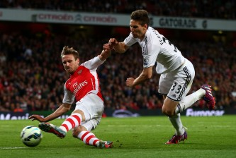LONDON, ENGLAND - MAY 11:  Nacho Monreal of Arsenal takes a shot at goal under pressure from Federico Fernandez of Swansea City during the Barclays Premier League match between Arsenal and Swansea City at Emirates Stadium on May 11, 2015 in London, England.  (Photo by Clive Rose/Getty Images)