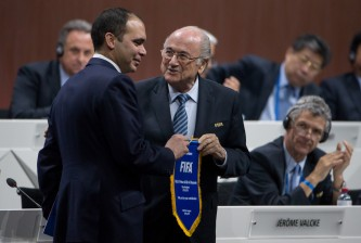 ZURICH, SWITZERLAND - MAY 29: Jordanian Prince Ali bin al Hussein, FIFA vice president and Challenger to Joseph S. Blatter for the FIFA presidency (L) receives a pennant from FIFA President Joseph S. Blatter during the 65th FIFA Congress at Hallenstadion on May 29, 2015 in Zurich, Switzerland. (Photo by Philipp Schmidli/Getty Images)