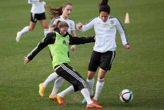 MARBELLA, SPAIN - FEBRUARY 09: Bianca Schmidt (C) duels for the ball with Sara Daebritz (L) and Celia Sasic (R) during a Germany Women's Training Session at Marbella Football Center  on February 9, 2015 in Marbella, Spain.  (Photo by Sergio Camacho/Getty Images)