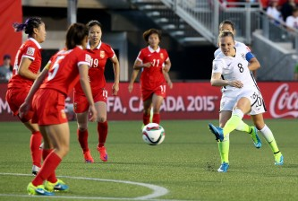 OTTAWA, ON - JUNE 26: Amy Rodriguez #8 of the United States shoots against China in the second half in the FIFA Women's World Cup 2015 Quarter Final match at Lansdowne Stadium on June 26, 2015 in Ottawa, Canada.  (Photo by Andre Ringuette/Freestyle Photo/Getty Images)