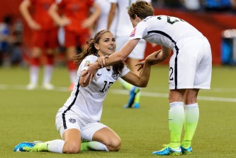 MONTREAL, QC - JUNE 30:  Alex Morgan #13 of the United States reacts with teammate Meghan Klingenberg #22 after Morgan was fouled in the box in the second half against Germany in the FIFA Women's World Cup 2015 Semi-Final Match at Olympic Stadium on June 30, 2015 in Montreal, Canada.  (Photo by Minas Panagiotakis/Getty Images)