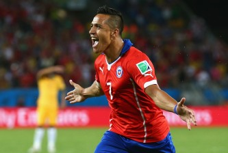 CUIABA, BRAZIL - JUNE 13:  Alexis Sanchez of Chile celebrates after scoring his team's first goal during the 2014 FIFA World Cup Brazil Group B match between Chile and Australia at Arena Pantanal on June 13, 2014 in Cuiaba, Brazil.  (Photo by Cameron Spencer/Getty Images)