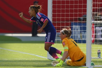 EDMONTON, AB - JULY 01:  (L-R) Yuki Ogimi #17 of Japan celebrates the late own goal in front of Karen Bardsley #1 of England during the FIFA Women's World Cup Canada 2015 Semi Final match at Commonwealth Stadium on July 1, 2015 in Edmonton, Canada.  (Photo by Ronald Martinez/Getty Images)