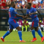 FRISCO, TX - JULY 07:  Duckens Nazon #20 of Haiti reacts with Jeff Louis #10 of Haiti after scoring against Panama during the 2015 CONCACAF Gold Cup Group A match between Panama and Haiti at Toyota Stadium on July 7, 2015 in Frisco, Texas.  (Photo by Tom Pennington/Getty Images)