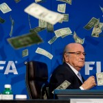 ZURICH, SWITZERLAND - JULY 20: Comedian Simon Brodkin (not pictured) throws cash at FIFA President Joseph S. Blatter during a press conference at the Extraordinary FIFA Executive Committee Meeting at the FIFA headquarters on July 20, 2015 in Zurich, Switzerland. (Photo by Philipp Schmidli/Getty Images)