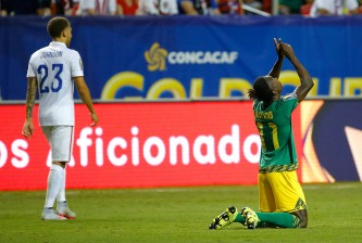 ATLANTA, GA - JULY 22:  Darren Mattocks #11 of Jamaica celebrates scoring the opening goal against the United States of America during the 2015 CONCACAF Golf Cup Semifinal match between Jamaica and the United States at Georgia Dome on July 22, 2015 in Atlanta, Georgia.  (Photo by Kevin C. Cox/Getty Images)