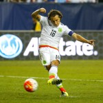 ATLANTA, GA - JULY 22:  Andres Guardado #18 of Mexico scores on this penalty kick in extra time against Panama during the 2015 CONCACAF Golf Cup Semifinal match between Mexico and Panama at Georgia Dome on July 22, 2015 in Atlanta, Georgia.  (Photo by Kevin C. Cox/Getty Images)