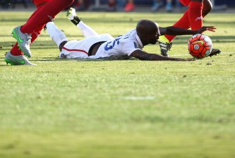 CHESTER, PA - JULY 25: DeMarcus Beasley #25 of the United States is tripped up against Panama in the second half during the CONCACAF Gold Cup Third Place Match at PPL Park on July 25, 2015 in Chester, Pennsylvania. Panama won in a penalty shootout. (Photo by Patrick Smith/Getty Images)