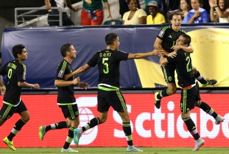 PHILADELPHIA, PA - JULY 26: Andres Guardado #18 of Mexico celebrates with teammates after scoring in the first half against Jamaica during the CONCACAF Gold Cup Final at Lincoln Financial Field on July 26, 2015 in Philadelphia, Pennsylvania. (Photo by Patrick Smith/Getty Images)