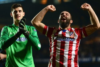 LONDON, ENGLAND - APRIL 30: Arda Turan (R) and Thibaut Courtois of Club Atletico de Madrid celebrate victory after the UEFA Champions League semi-final second leg match between Chelsea and Club Atletico de Madrid at Stamford Bridge on April 30, 2014 in London, England.  (Photo by Jamie McDonald/Getty Images)