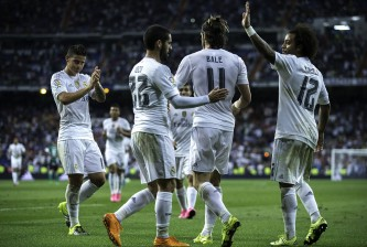 MADRID, SPAIN - AUGUST 29:  Gareth Bale (2ndR) of Real Madrid CF celebrates scoring their fifth goal with teammates James Rodriguez (L), Francisco Roman Alarcon alias Isco (2ndL) and Marcelo (R) during the La Liga match between Real Madrid CF and Real Betis Balompie at Estadio Santiago Bernabeu on August 29, 2015 in Madrid, Spain.  (Photo by Gonzalo Arroyo Moreno/Getty Images)