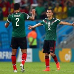 RECIFE, BRAZIL - JUNE 23:  Francisco Javier Rodriguez and Paul Aguilar of Mexico celebrate during the 2014 FIFA World Cup Brazil Group A match between Croatia and Mexico at Arena Pernambuco on June 23, 2014 in Recife, Brazil.  (Photo by Michael Steele/Getty Images)