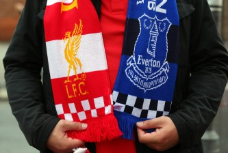 LIVERPOOL, ENGLAND - SEPTEMBER 27:  A supporter wears a friendship of Liverpool and Everton priorto the Barclays Premier League match between Liverpool and Everton at Anfield on September 27, 2014 in Liverpool, England.  (Photo by Alex Livesey/Getty Images)