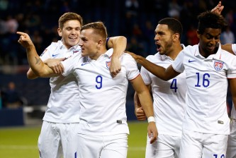 KANSAS CITY, KS - OCTOBER 01:  Jordan Morris #9 of the USA celebrates with teammates after scoring a goal during the 1st minute of the 2015 CONCACAF Olympic Qualifying match against Canada at Sporting Park on October 1, 2015 in Kansas City, Kansas.  (Photo by Jamie Squire/Getty Images)