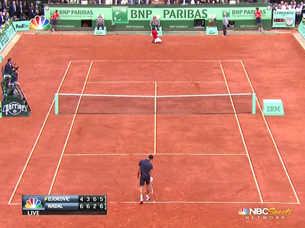 This screengrab of NBC Sports Network's 2012 French Open men's final broadcast shows Rafael Nadal celebrating after Novak Djokovic double-faulted on match point. How eerily noteworthy it is that Djokovic double-faulted on match point two years later in the same situation, losing in four sets on a day when he could have done better. (Image courtesy of Business Insider)
