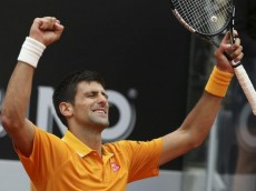 Djokovic of Serbia celebrates after winning his semi-final match against Ferrer of Spain at the Rome Open tennis tournament in Rome
