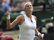Victoria Azarenka of Belarus reacts after winning the first set during her match against Serena Williams of the U.S.A. at the Wimbledon Tennis Championships in London