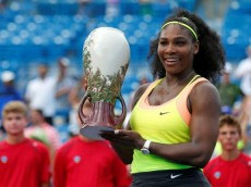Aug 23, 2015; Cincinnati, OH, USA; Serena Williams (USA) holds the Rookwood Cup after defeating Simona Halep (not pictured) in the finals during the Western and Southern Open tennis tournament at the Linder Family Tennis Center. Mandatory Credit: Aaron Doster-USA TODAY Sports
