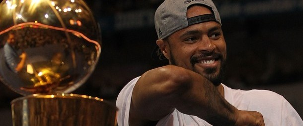 tyson_chandler_with_the_nba_championship_trophy_and_a_hat_on_backwards