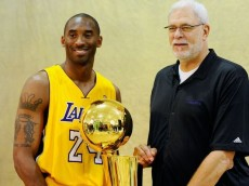 Kobe Bryant poses with Phil Jackson and the Lakers 2010 Championship trophy