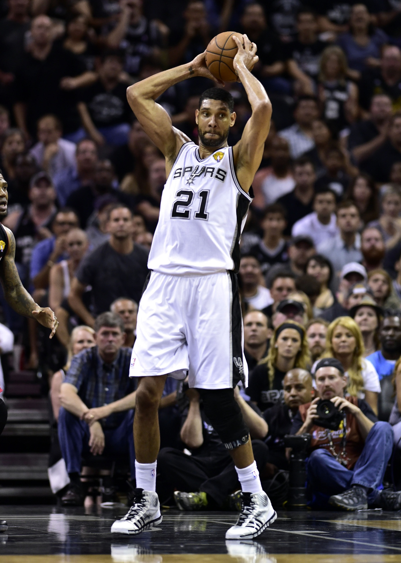 He might not stand alone relative to anyone else who's played the game, but Tim Duncan certainly stands tall, a champion after the 2013 Finals he vowed to avenge.