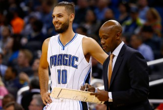 ORLANDO, FL - NOVEMBER 14:  Head coach Jacque Vaughn of the Orlando Magic (R) speaks with Evan Fournier #10 during the game against the Milwaukee Bucks at Amway Center on November 14, 2014 in Orlando, Florida. The Magic won the game 101-85.  NOTE TO USER: User expressly acknowledges and agrees that, by downloading and/or using this Photograph, user is consenting to the terms and conditions of the Getty Images License Agreement.  (Photo by Sam Greenwood/Getty Images)