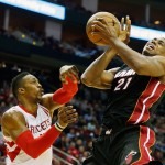 HOUSTON, TX - JANUARY 03:  Dwight Howard #12 of the Houston Rockets battles for a loose basketball with Hassan Whiteside #21 of the Miami Heat during their game at the Toyota Center on January 3, 2015 in Houston, Texas.  NOTE TO USER: User expressly acknowledges and agrees that, by downloading and/or using this photograph, user is consenting to the terms and conditions of the Getty Images License Agreement.  (Photo by Scott Halleran/Getty Images)