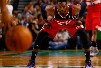 BOSTON, MA - APRIL 16:  John Wall #2 of the Washington Wizards waits to defend against the Boston Celtics in the second half during the game at TD Garden on April 16, 2014 in Boston, Massachusetts. NOTE TO USER: User expressly acknowledges and agrees that, by downloading and or using this photograph, User is consenting to the terms and conditions of the Getty Images License Agreement.  (Photo by Jared Wickerham/Getty Images)