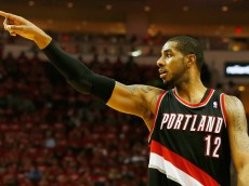 HOUSTON, TX - APRIL 23:  LaMarcus Aldridge #12 of the Portland Trail Blazers celebrates a play on the court in the second half of the game against the Houston Rockets in Game Two of the Western Conference Quarterfinals during the 2014 NBA Playoffs at Toyota Center on April 23, 2014 in Houston, Texas. NOTE TO USER: User expressly acknowledges and agrees that, by downloading and or using this photograph, User is consenting to the terms and conditions of the Getty Images License Agreement.  (Photo by Scott Halleran/Getty Images)