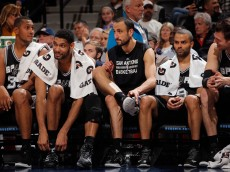 DENVER, CO - JANUARY 20:  (L-R) Boris Diaw #33, Tim Duncan #21, Manu Ginobili #20, Tony Parker #9 and Tiago Splitter #22 of the San Antonio Spurs sit on the bench late in the game against the Denver Nuggets at Pepsi Center on January 20, 2015 in Denver, Colorado. The Spurs defeated the Nuggets 109-99. NOTE TO USER: User expressly acknowledges and agrees that, by downloading and or using this photograph, User is consenting to the terms and conditions of the Getty Images License Agreement.  (Photo by Doug Pensinger/Getty Images)