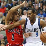 DALLAS, TX - JANUARY 23:  Rajon Rondo #9 of the Dallas Mavericks dribbles the ball against Derrick Rose #1 of the Chicago Bulls at American Airlines Center on January 23, 2015 in Dallas, Texas.  NOTE TO USER: User expressly acknowledges and agrees that, by downloading and or using this photograph, User is consenting to the terms and conditions of the Getty Images License Agreement.  (Photo by Ronald Martinez/Getty Images)