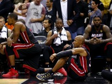 SAN ANTONIO, TX - JUNE 15:  Chris Bosh #1 and Ray Allen #34 of the Miami Heat look on from the bench in the closing minutes against the San Antonio Spurs during Game Five of the 2014 NBA Finals at the AT&T Center on June 15, 2014 in San Antonio, Texas. NOTE TO USER: User expressly acknowledges and agrees that, by downloading and or using this photograph, User is consenting to the terms and conditions of the Getty Images License Agreement.  (Photo by Andy Lyons/Getty Images)
