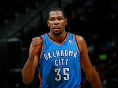 ATLANTA, GA - DECEMBER 10:  Kevin Durant #35 of the Oklahoma City Thunder reacts after a basket against the Atlanta Hawks at Philips Arena on December 10, 2013 in Atlanta, Georgia.   NOTE TO USER: User expressly acknowledges and agrees that, by downloading and or using this photograph, User is consenting to the terms and conditions of the Getty Images License Agreement.  (Photo by Kevin C. Cox/Getty Images)