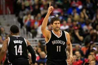 WASHINGTON, DC - JANUARY 16: Brook Lopez #11 of the Brooklyn Nets celebrates after making a second half basket against the Washington Wizards during the Nets 102-80 win at Verizon Center on January 16, 2015 in Washington, DC. NOTE TO USER: User expressly acknowledges and agrees that, by downloading and or using this photograph, User is consenting to the terms and conditions of the Getty Images License Agreement.  (Photo by Rob Carr/Getty Images)